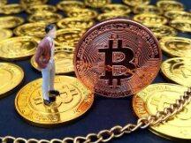比特币究竟是不是骗局?比特币2025年价格会到多少?