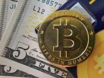 比特币突破47000万美元 一枚比特币可换一斤半黄金